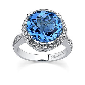 White gold diamond and blue topaz ring