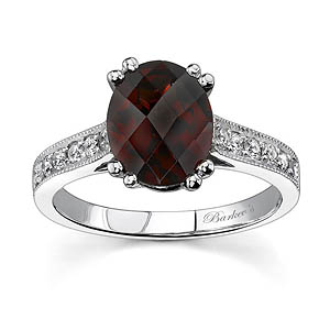 White gold diamond and red garnet ring
