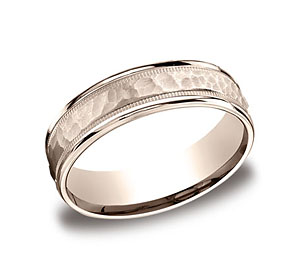 This 6mm comfort-fit carved design band features a hammered-finished center with a milgrain pattern along the high polished edge for a stylish look.