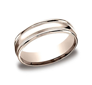 This 6mm comfort-fit carved design band features a high polished finish with milgrain and a round edge.