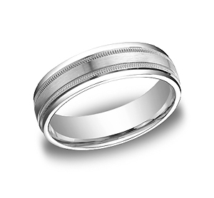 This Platinum 6mm comfort-fit carved design band features a satin-finished center with milgrain and a high polished round edge.