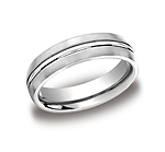 This 6mm comfort-fit satin-finished carved design band features a high polished cut along the center.
