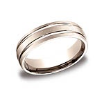 This incredible 6mm comfort-fit carved design band features a satin-finished with two high polished paralle...