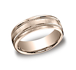 This 7.5mm satin-finished comfort-fit carved design band features two rope patterns along the center.