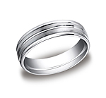 This incredible Platinum 6mm comfort-fit satin-finished carved design band features a high polished round e...
