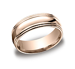 This unique 7.5mm comfort-fit high polished carved design band features a high polished double round edge...