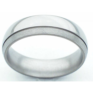 6MM DOMED TITANIUM BAND WITH (1).5MM OFF CENTER GROOVE. THE BIGGER EDGE IS POLISHED AND THE SMALLER IS IN STONE.