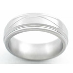 7MM FLAT TITANIUM BAND WITH HALF INFINITY TOOLING IN A SATIN FINISH.