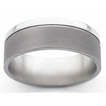 8MM FLAT TITANIUM BAND WITH(1).5MM OFF CENTER GROOVE. THE LARGE EDGE IS...